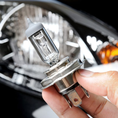 halogen light bulb H4 over black car